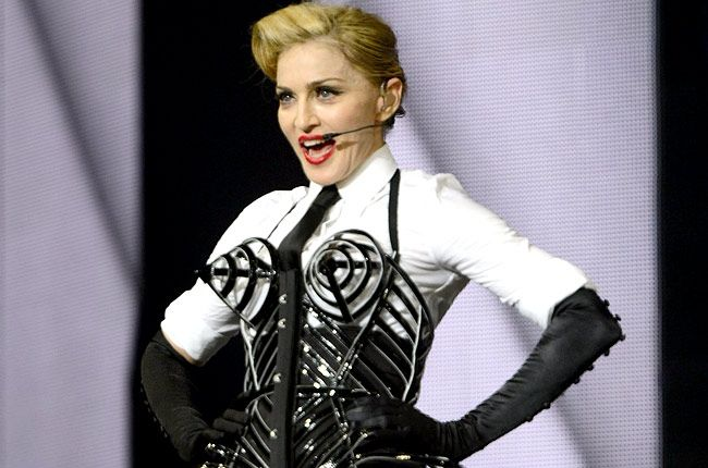 Madonna's needs truly match her huge celebrity status. It was reported that she would require that all of the furniture in her dressing rooms be emptied. What would she need the space for? She would rather ship and use her own furniture instead. If you think that's difficult, she was also said to require special pink and white roses with stems that must be cut exactly to six inches. Other sources claimed that she needed 20 international phone lines in her room as well.