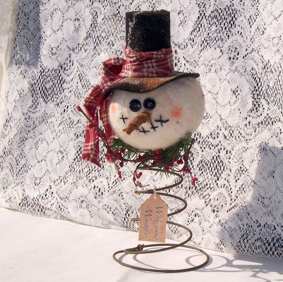 Primitive Snowman nodder make do ornie tea dyed  tree topper rusty spring warm and natural. $13.99, via Etsy.