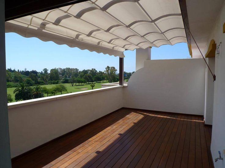 coberti toldo horizontal de ondas para prgola de madera en terraza de vivienda unifamiliar