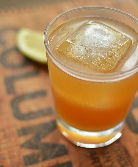 The Gold Rush:  3 tablespoons honey  2 tablespoons boiling water  4 ounces (1/2 cup) bourbon   1 1/2 lemons, juiced, about 4 tablespoons
