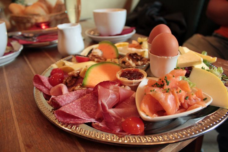 Berlin Brunch - A typical Berlin brunch means a buffet-style meal with sliced deli meats, cheeses, soft-boiled eggs and fruits. And sausages – this is Germany, remember?