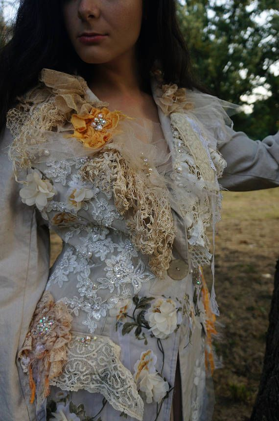 Romantic baroque inspired feminine jacket. The jacket is made from ivory linen. Its decorated with variety of antique and vintage laces, tulles, white organza piece with flowers, hand sculpted lace flowers, vintage beaded pieces. The coat is adorned with pearls, crystals and beading. The
