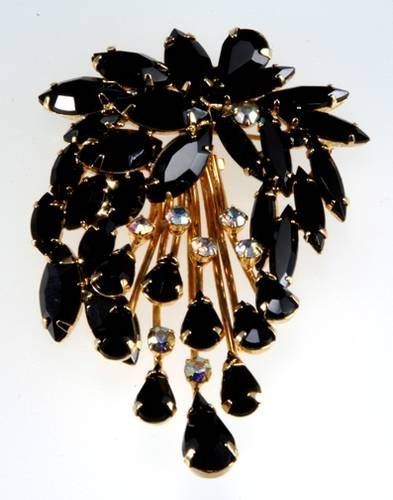 Signed Napier brooch featuring black rhinestones with aurora borealis accents in a heavy goldtone setting.