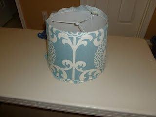 Lampshade Redo- was going to buy a new lampshade for the living room, but maybe i'll just get some new fabric and do this