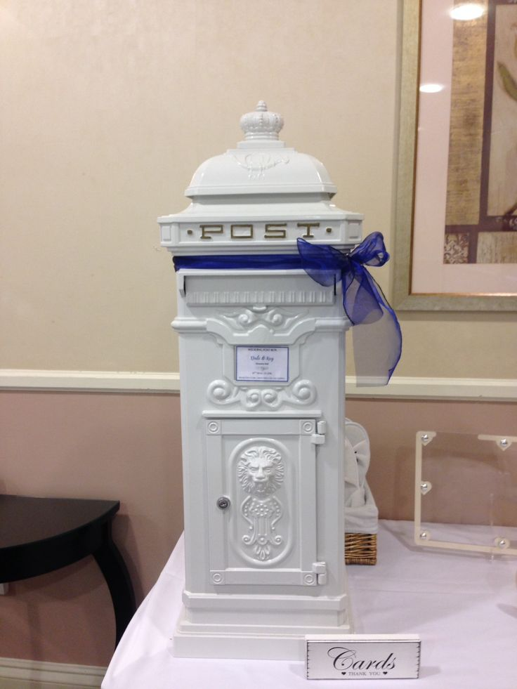 Lovely replica post box has personalised label and keeps cards secure. It is available to hire from makeitspecialevents.co.uk