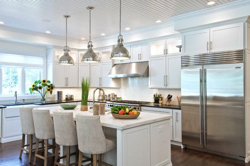 traditional white kitchen with island & industrial touches #marble #island