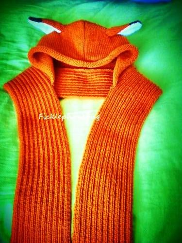 This is so neat. The original pattern is here: http://www.cutoutandkeep.net/projects/kitty_hood_scarf_with_pockets But I like the red fox version rather than the cat version. Very cool!!