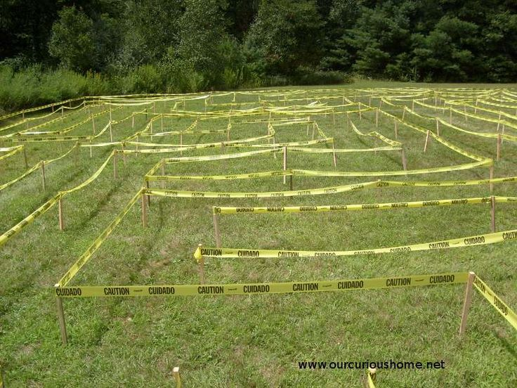 """Great idea for making a maze for the kids! Wooden stakes and """"caution"""" tape."""