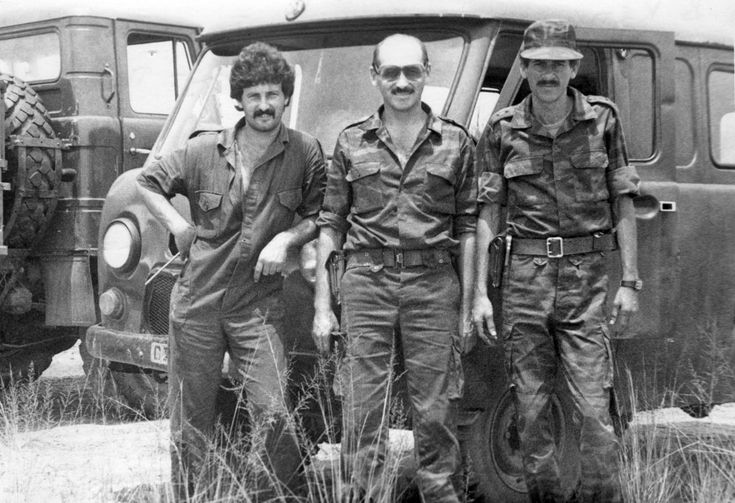 Cuban soldiers pose with Soviet officer in Angola in 1988.