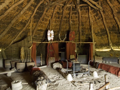 Celtic:  Recreation of the interior and furnishings of an Iron-Age Celtic roundhouse, Castell Henlly, Pembrokeshire, Wales. Photo by John Warburton-lee.