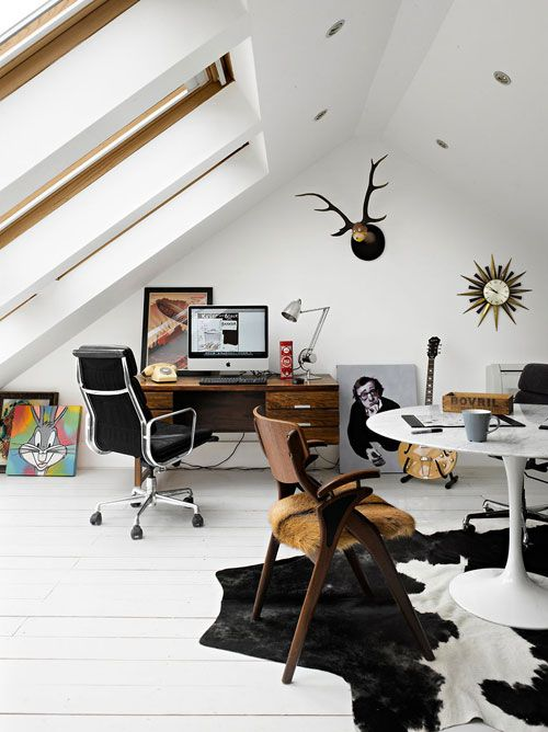 This home office has a little bit of everything. Perfect for someone with eclectic tastes and a sense of humor.