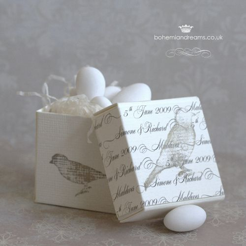 Birds nest box wedding favour. Delicate stamps of vintage birds and nest decorate this ethereal box. The lid also features a paper sash featuring sophisticated calligraphy with your names, wedding date and a thank you message. Personal and lovely! Would look lovely filled with chocolate eggs. £4.50 per item