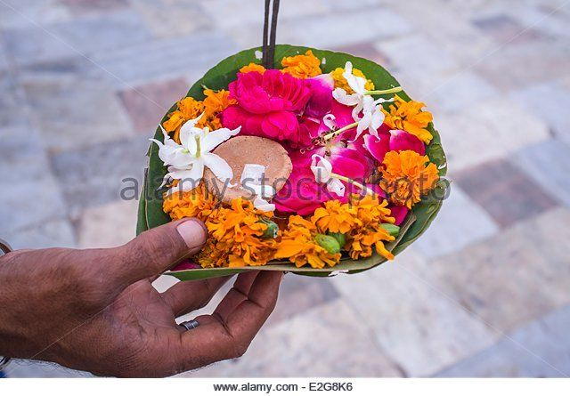India Uttarakhand State Haridwar one of the nine holy cities to Hindus on the banks of the Ganga river offerings - Stock Image