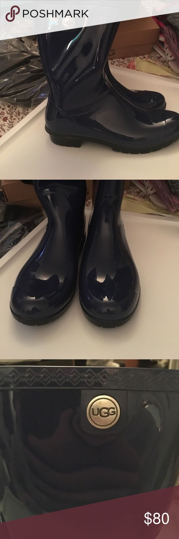 Brand new indigo blue short ugg rain boots Brand new, short indigo blue rain boots. Has ugg emblem on outer side of boot and real lamb fur as the inside sole of the boot UGG Shoes Winter & Rain Boots