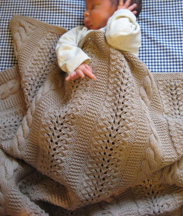 Free Knitting Pattern for Heavenly Blanket - Designed by Joyce Nordstorm for Red Heart, this combination of cable panels and lacework creates a baby blanket that will become a family favorite. Blanket measures 37″ x 42″. Pictured project by Posh Knits #forme