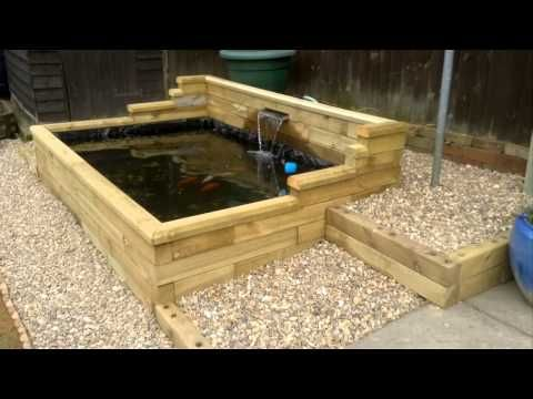 Wooden raised pond google search outdoor living for Wooden koi pool