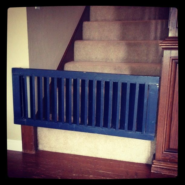 DIY Baby gate from an old wooden shutter