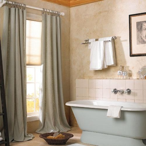 Extra long gray curtains with peachy cream cell shade.  You have it all in this color coordinated bathroom!