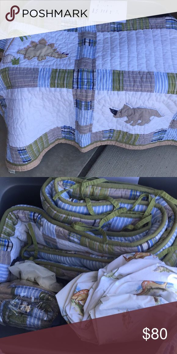 Pottery Barn Dinosaur Crib Set Excellent condition PB Crib Set! Includes quilt, bumper, sheets & bedskirt, as well as a pillow sham which is still new in package! So soft! Back of quilt and bumper have blue and white stripes, all have dinosaurs and madras print accents. Pottery Barn Other