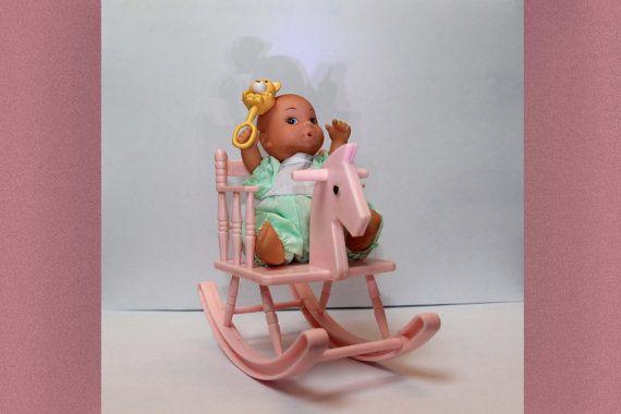 Vintage babypopje met schommelstoel/paard van PinchOfRetro op Etsy
