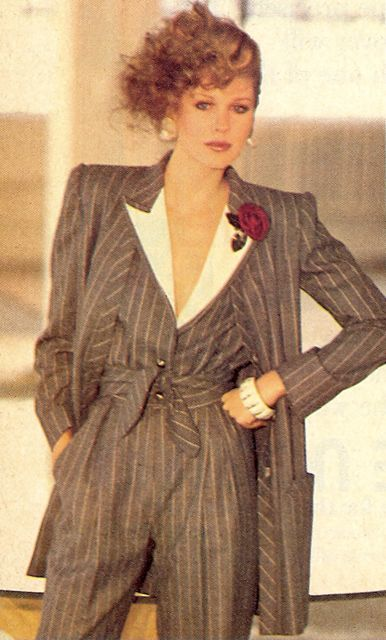 Shoulder pads had made a comeback in the 1980s. This was known for power dressing. This means that women back in the day showing their equality to men ,seeking success and power. Also, I notice that she was wearing Madonna's hairstyle. And jewelry was an important part in fashion to complete the look