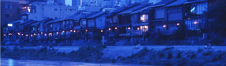 Kamo river is lined with restaurants overlooking the water.