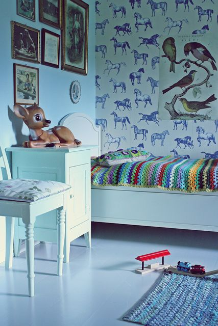 vintage style kids room with horse wall paper and gallery wall of antique framed pictures