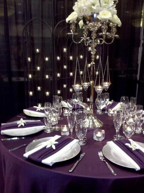 @Kasey Pietenpol~how Pretty is this! Love the purple table cloth with silver chargers & purple napkins:)