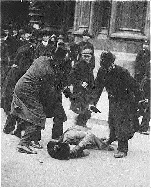 Suffragette Ada Wright collapses through police violence on Black Friday November 18 1910. Following a failed bill in Parliament to further the rights of women, Home Secretary Winston Churchill ordered the police to use force to disperse a peaceful protest.