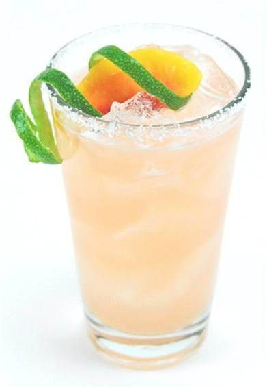 WHITE PEACH BLOSSOM MARTINI: 1 part Absolut Mandarin + 1 part white peach Schnapps + 1/2 part pineapple juice. Shake and serve with a peach or orange slice.