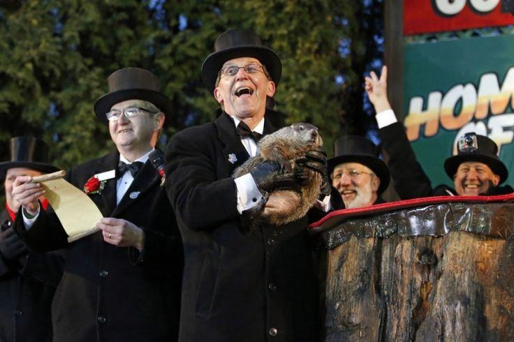 Punxsutawney, Pa. United States Groundhog Club handler Ron Ploucha holds Punxsutawney Phil, the weather prognosticating groundhog, during the 129th celebration of Groundhog Day on Gobbler's Knob. Phil's handlers said that the groundhog has forecast six more weeks of winter weather