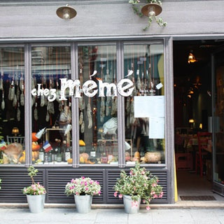 """Chez Mémé: A playful restaurant hidden around the corner from chez nous on Rue Saint Denis, a street once known exclusively for it's sex-shops and """"les filles de joie."""" Today this street has many of my favorite restaurants, Chez Mémé topping the list. Love the plants hanging from the ceiling, the meat hanging in the window, and the chalkboard writing on the wall. The food and wine are fantastic....and the escargot is to DIE for. http://www.chezmeme.fr/"""
