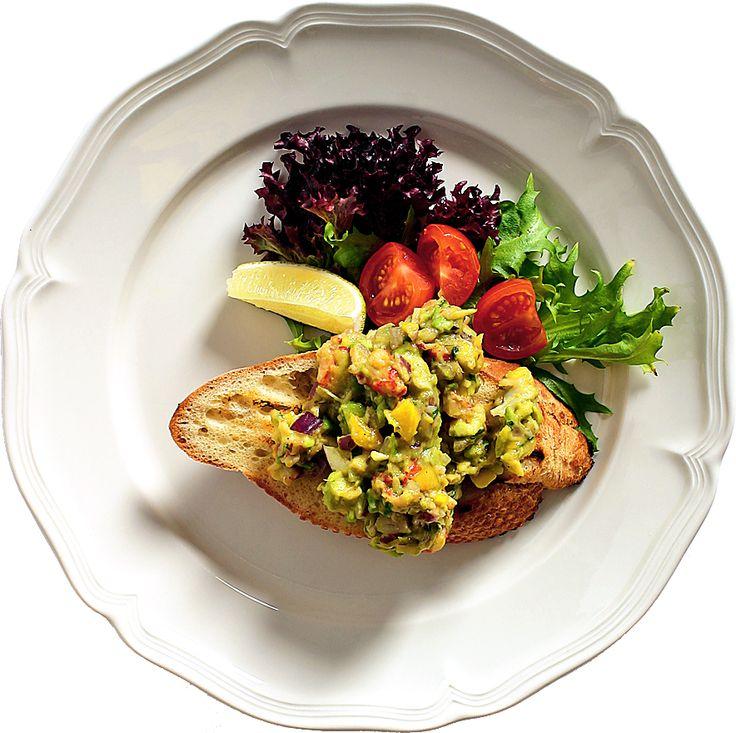 En bruschetta är en grillad brödskiva som serveras med trevligt grönsakshack på toppen. Servera som en lätt förrätt eller drinktilltugg.
