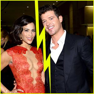 Robin Thicke & Paula Patton Split After 8 Years of Marriage....who didn't see this coming since the show Miley Cyrus grinded on him and then the pic where he got caught with his hand up some hottie's butt in the mirror behind them came out!!!  lol   Lesson to learn...if you are going to grope some woman other than your wife...don't have your pic taken doing it and even more so...check for mirrors behind you!!