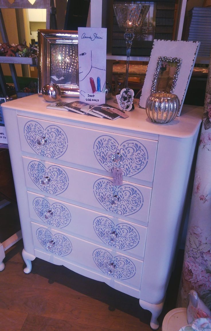Drawers painted in Original with heart stencil and crystal drawer knobs