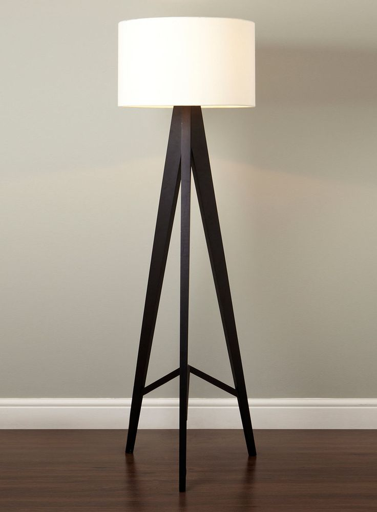 Cute Tripod Floor Lamp Design Inspiration Come With Cream Scheme Drum Shaped Shade Lamp And 3 Black Stained Wooden Tripod Floor Lamp Legs Also White Grey Painted Wall Together Laminated Wooden Flooring