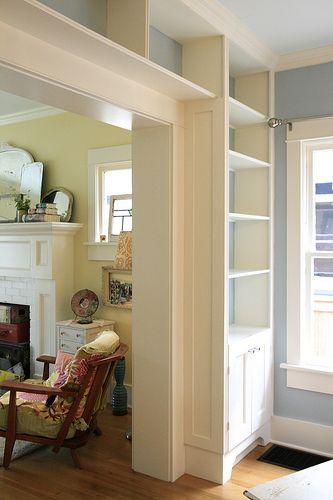 Bookcase surrounding a door.