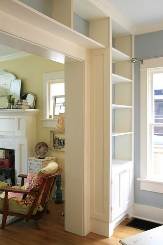 "Interesting idea maybe for wall between dining & living rooms ?! ... ""Bookcase surrounding a door - would do this but keep it bungalow style with dark wood and see through to the other room. Great detailing!"""