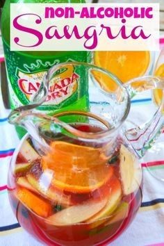 Non Alcoholic Sangria Punch: I used non alcoholic red wine instead of cranberry juice,substituted 5 Alive (3 drink boxes) for the pineapple juice added a small bottle of Pom juice, one sliced lemon,1 lime and mixed frozen fruit. Added the ginger ale later. Really good!