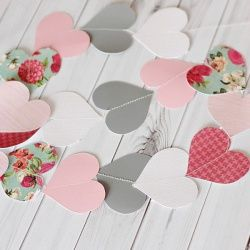 Decorate for valentine's day with this easy to make heart garland. Template included.