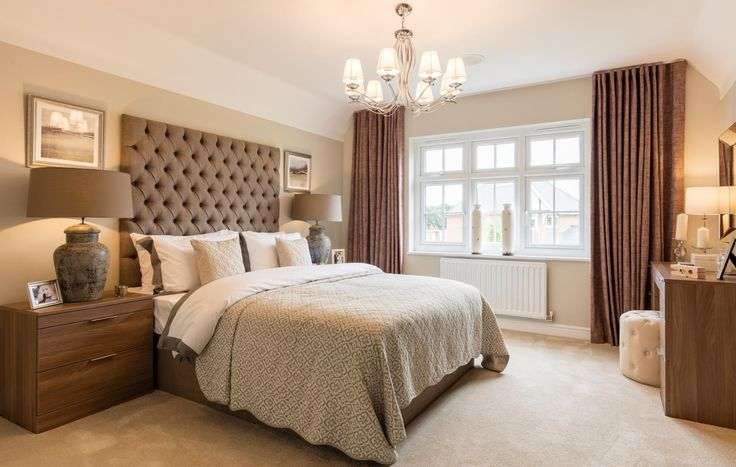 What guest wouldn't feel relaxed in this elegant bedroom? Combine calming neutral tones with a statement headboard and textured cushions and throws - time to get cosy!