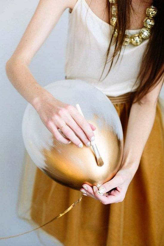 DIY gold decor - paint balloons a coat of metallic gold for that extra glam touch