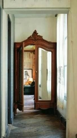The body of French antique armoire was not useable but the front frame and doors were rescued as an entry doorway into a room. Exquisite use of a beautiful old piece. #repurpose #antique