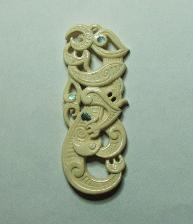 Double Manaia (spiritual guardian) carved from beefbone with pounamu(N.Z Jade) and Paua shell inlays