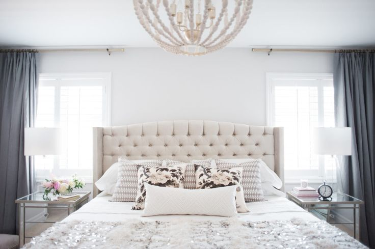 Toronto-based Krystin Lee, of the blog Suburban Faux Pas, enlisted the interior design help of designer Jacquelyn Clark to design the master bedroom of her Canadian home. I'm absolutely in love with the pink and gold wallpaper that lines the walls before her room. Inside, a lovely neutral-toned color scheme gives the room a relaxing feel. The cream tufted headboard …