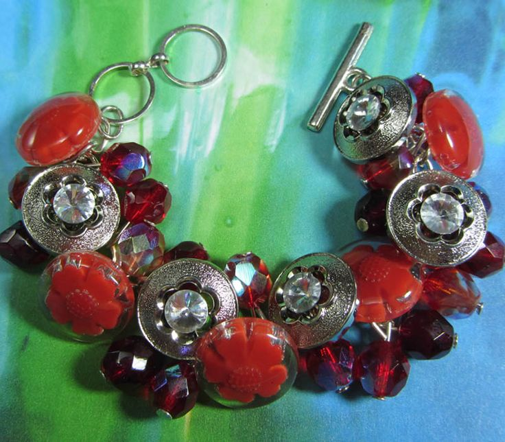 Hollywood Glam Flower Bracelet has Bold Silver and Red Flower Buttons and Red Fire Polished Czech Beads