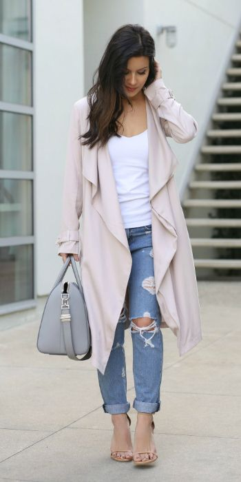 Andee Layne + perfect combination + glamour and edginess + street chic look + distressed denim jeans + white vest + statement drape coat + must have + style + highly recommend you + give it a go this season  Trench: Revolve, Tee: Singer22, Jeans: Rag & Bone.