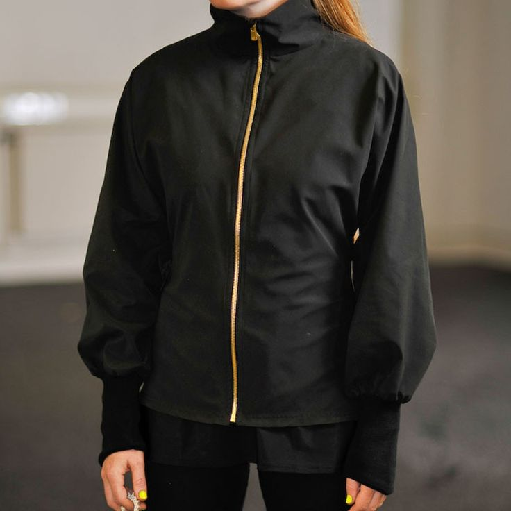 Cyclodelic Kimono Windbreaker (Black):  A new concept in technical 'outerwear', Cyclodelic's tailored lightweight jacket combines styling that enhances the female figure with considered functionality.    Soft peachskin microfibre with a durable water-repellent finish provides excellent protection against showers, and a high collar keeps the gusts out.  Sleeves are cut long, as is the back, and the signature kimono cut provides room to move to fit as you lean forward on your bike. £159