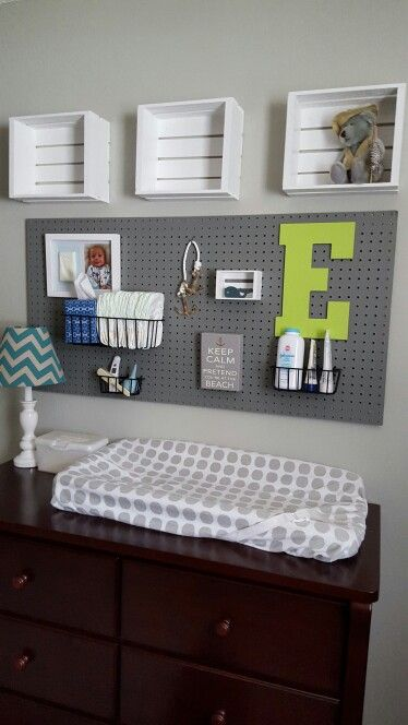 Baby boy nursery. Pegboard and crates.