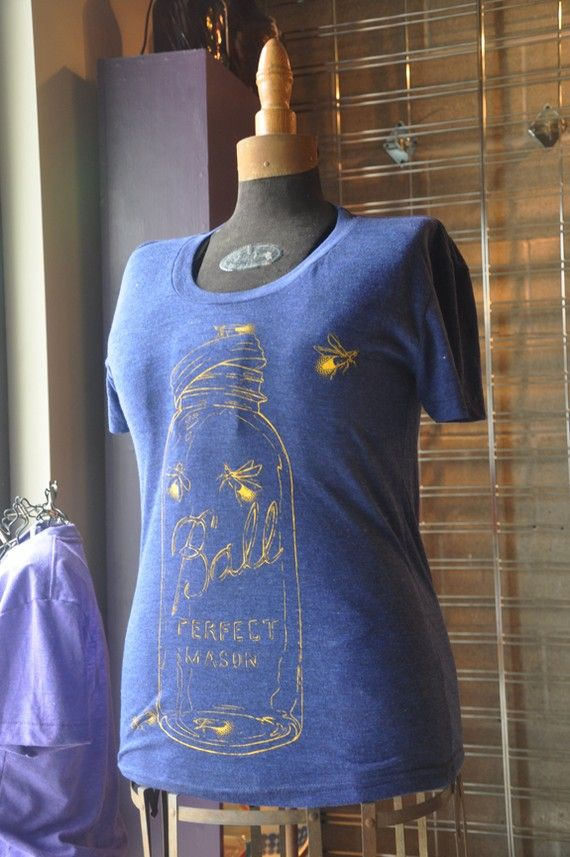 They're calling it a firefly tshirt but obviously those are lightning bugs escaping from that mason jar. (Either way I love it.)